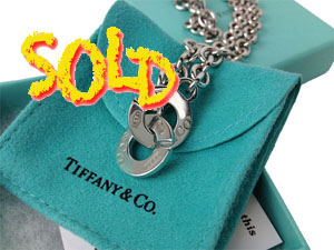 SOLD OUT Tiffany & Co . Singnature Interlocking Clasp necklace.