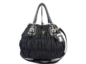 556ea8d676 Prada Black Nylon Gaufre Handle Sling Bag